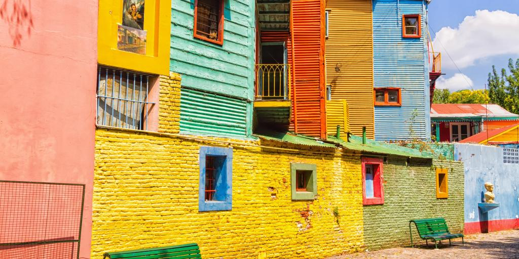 Bright yellow, green, orange and blue houses in the La Boca district of, Buenos Aires, Argentina