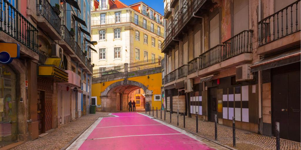 People walk down the famous Pink Street in Lisbon's Cais do Sodre area