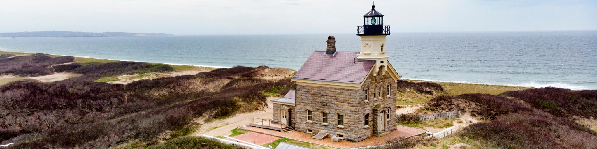 Classic lighthouse building looking out to sea on Block Island, Rhode Island.