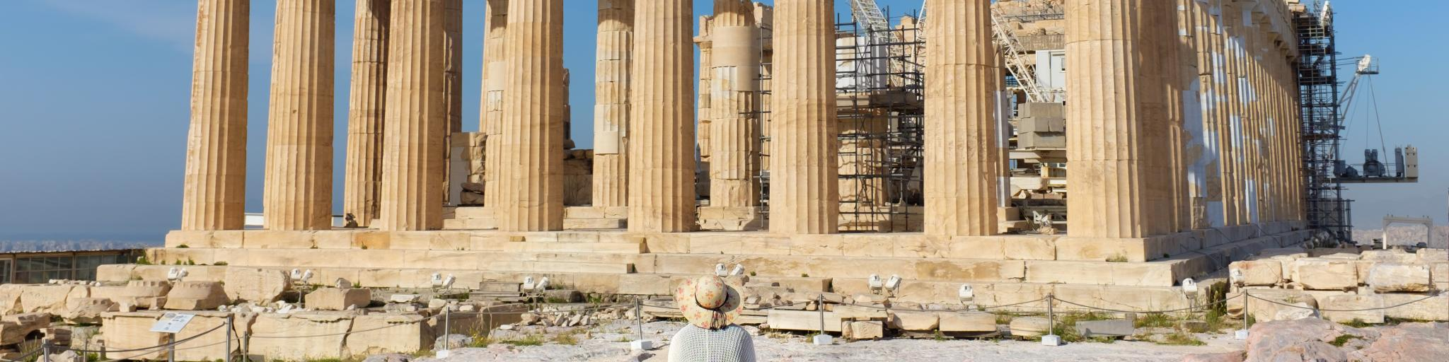 Lady sitting in front of Parthenon on Acropolis, Athens, Greece