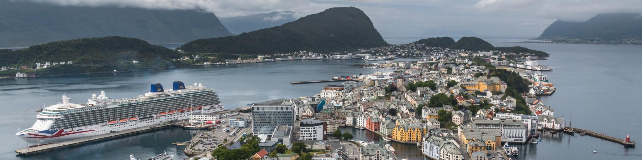 A cruise ship is docked in the port of Aalesend in Norway, the gateway to the fjords
