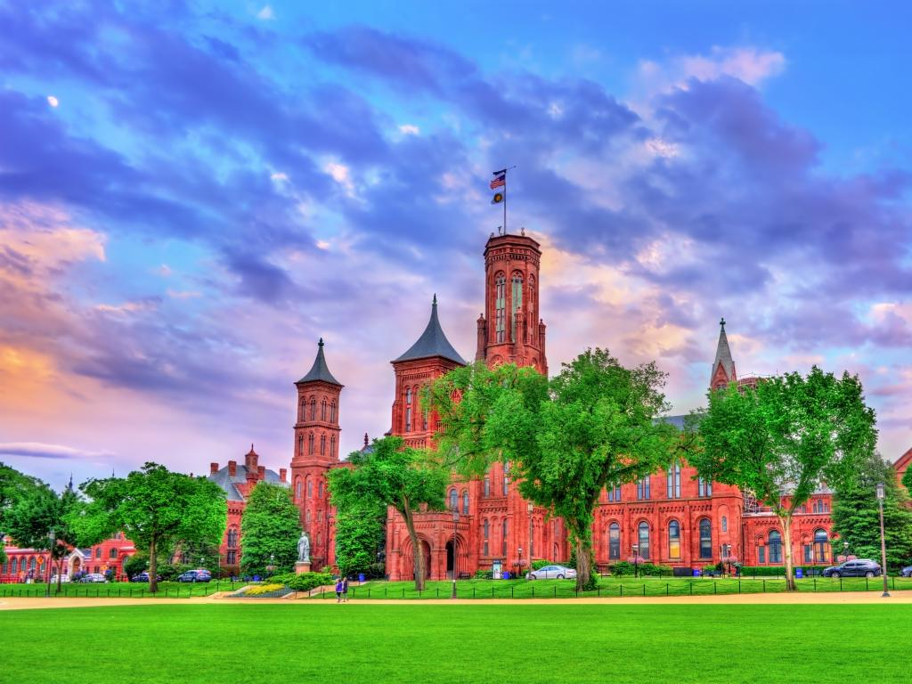 Smithsonian Castle in Washington DC with brighly lit evening sky in the background.