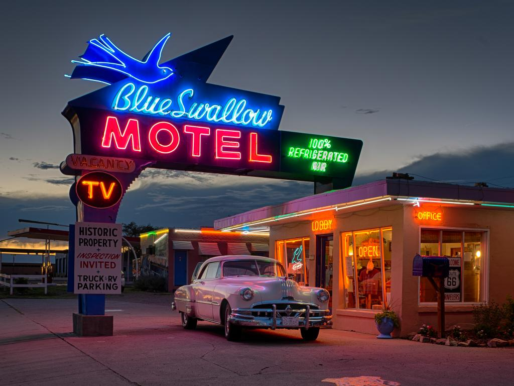 Classic car outside the historic Blue Swallow Motel on Tucumcari Boulevard, part of Route 66 in Tucumcari, New Mexico