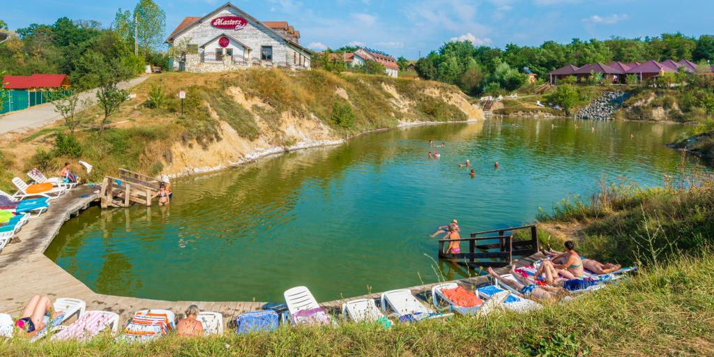 People swimming and sunbathing at Ocna Sibiului thermal salt lake, Romania