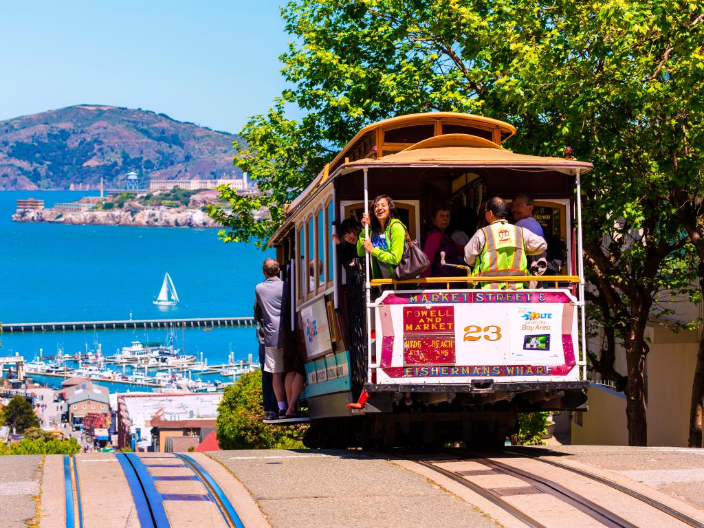 San Francisco Cable Car going downhill to the Bay in fine weather during April