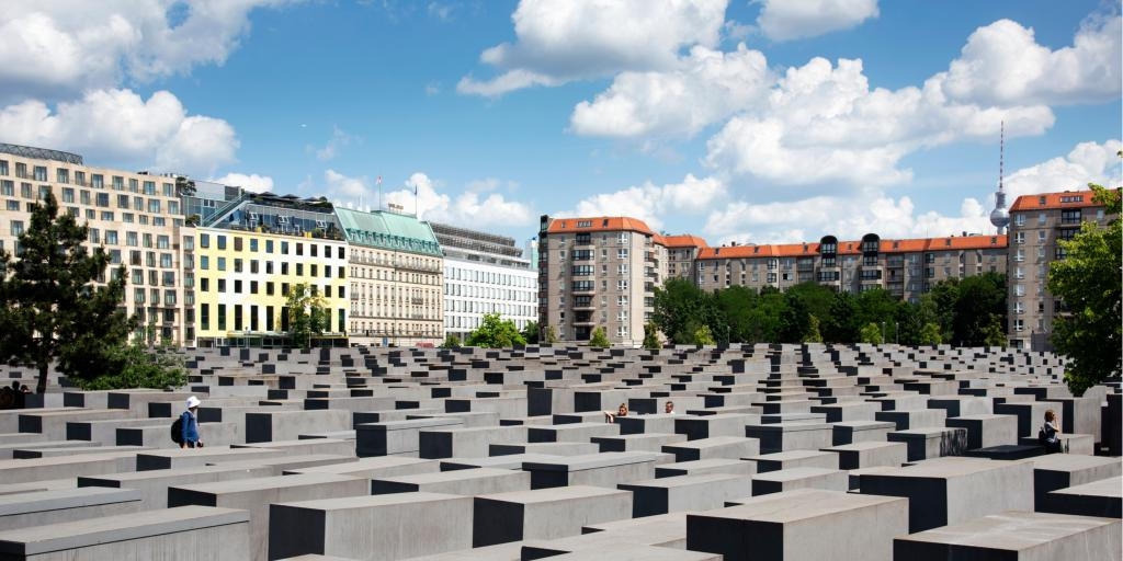 Visitors at the Memorial to the Murdered Jews of Europe, also known as Holocaust Memorial, in Berlin, Germany