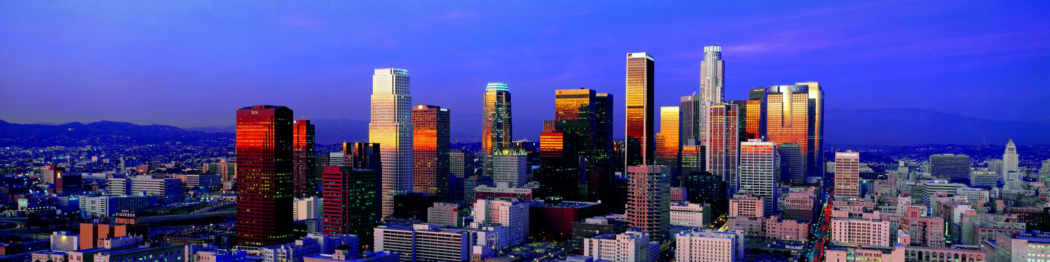 A beautiful view of the skyline with the light from the sunrise reflecting the buildings of Los Angeles
