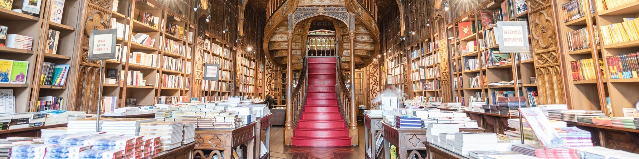 The magical staircase and ornate woodwork of Livreria Lello bookstore in Porto
