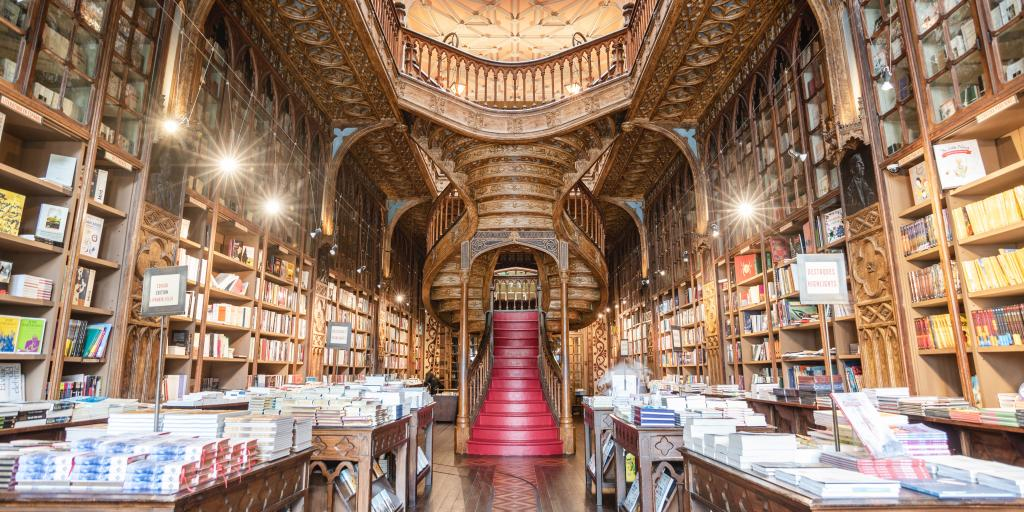 The magical staircase and ornate woodwork of Livreria Lello bookstore in Porto