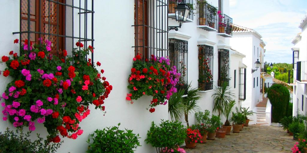 The white houses of Marbella are adorned with pink and red flowers