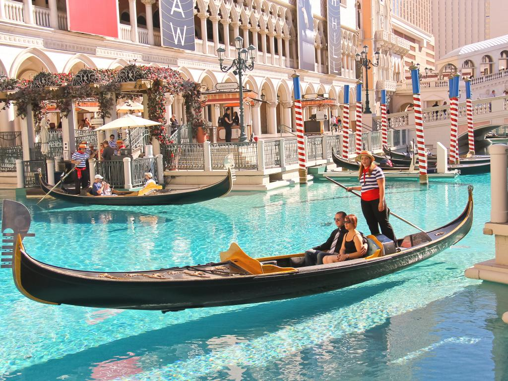 Tourists enjoying a real experience of Gondola ride in at the Grand Canal in Venetian Hotel Las Vegas