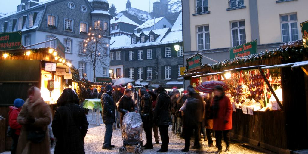 Snowy houses and stalls at Monschau Christmas Market, Germany