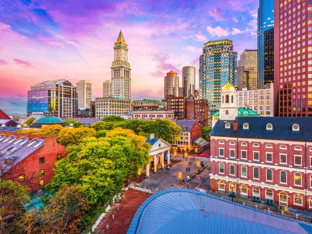 Skyline of Boston, Massachusetts, USA, against a purple sunset