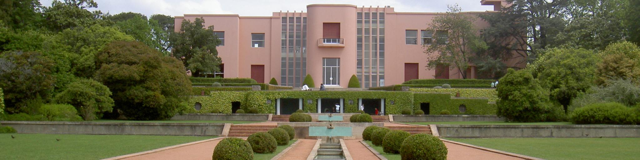 A walkway leading up to the distinctive pink Casa de Serralves, built in art deco style in Porto