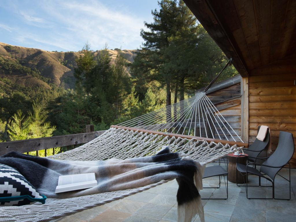 Views over the Big Sur mountains from a balcony with a hammock in Ventana Big Sur.