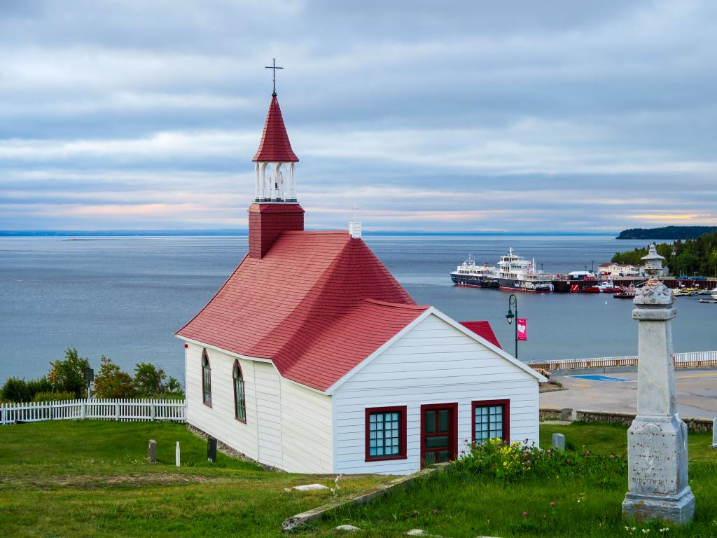 Tadoussac Chapel - Canada's oldest wooden church overlooking the St Lawrence River flowing into the Gulf of St Lawrence.