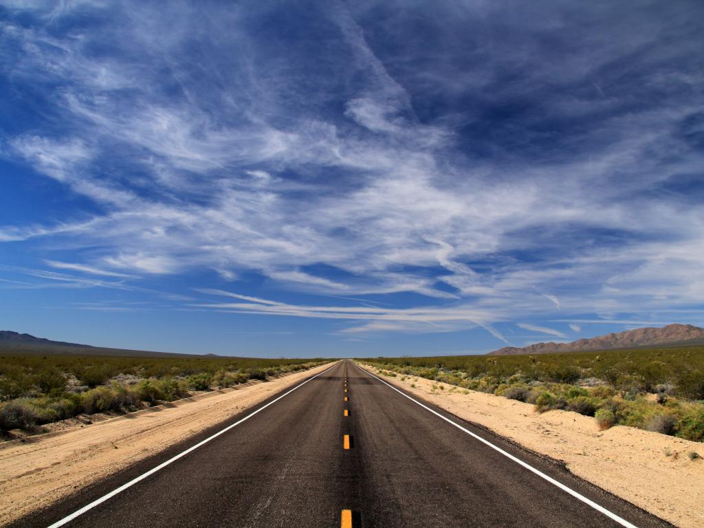 An empty highway of Interstate 40 on Mojave National Preserve first light