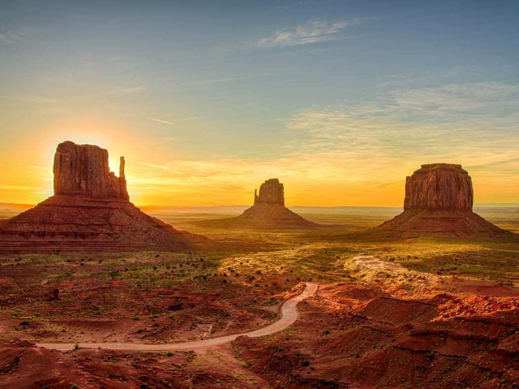 The iconic buttes of Monument Valley at sunrise on the Utah - Arizona border.