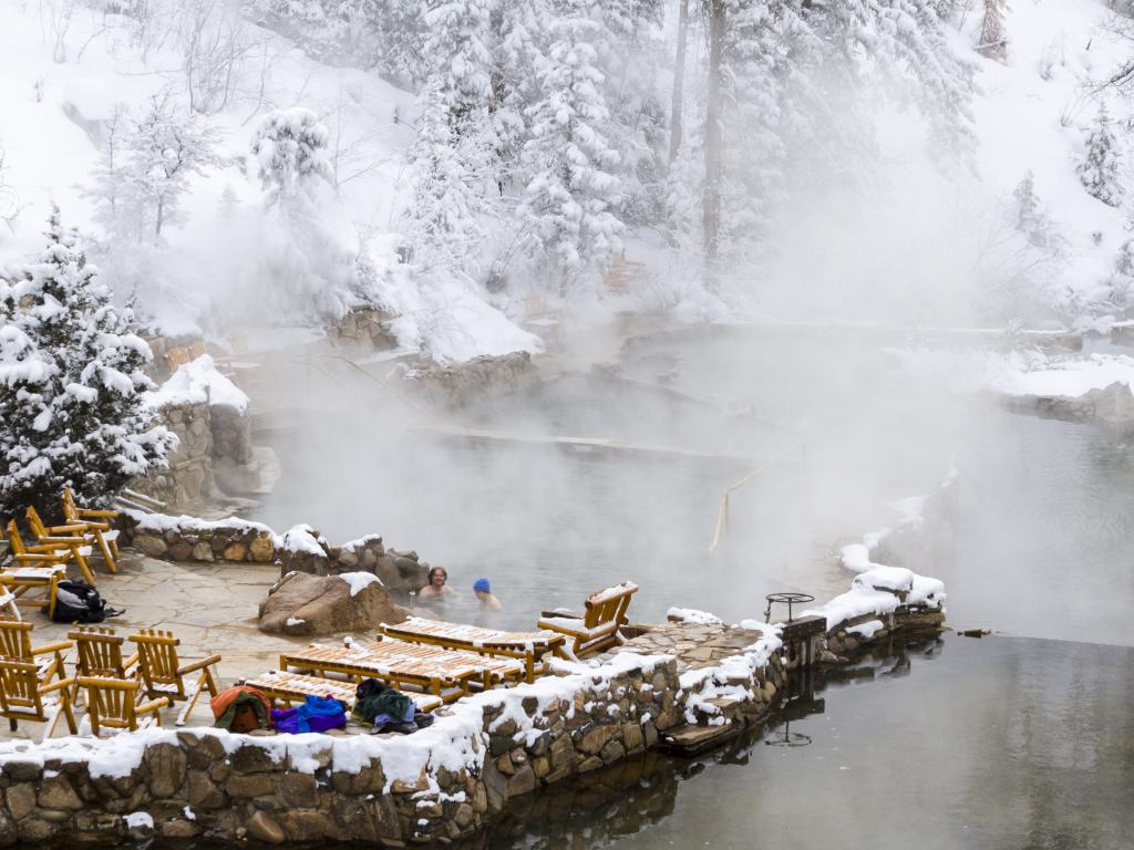 The hot water of Strawberry Park Hot Springs during a snowy winter, near Steamboat Springs, Colorado