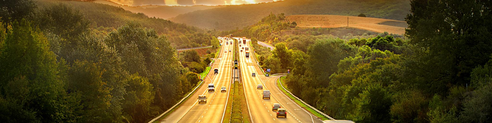 cars driving along the motorway at sunset