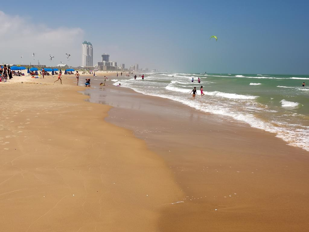 Long sandy beach with hotels in the background on South Padre Island, Texas.