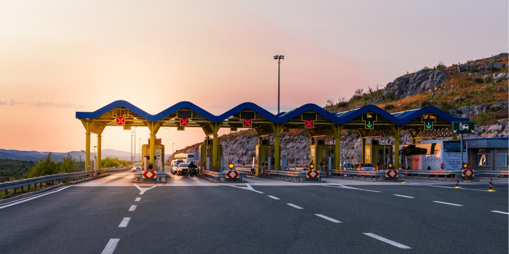 Cars pass through a toll road on a motorway in Croatia