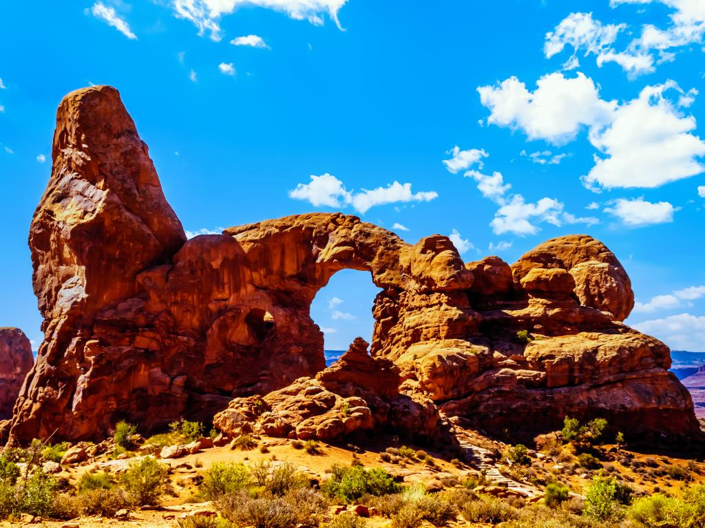 A sunny morning in the Arches National Park with one of the large Sandstone Arches, the Turret Arch in Utah