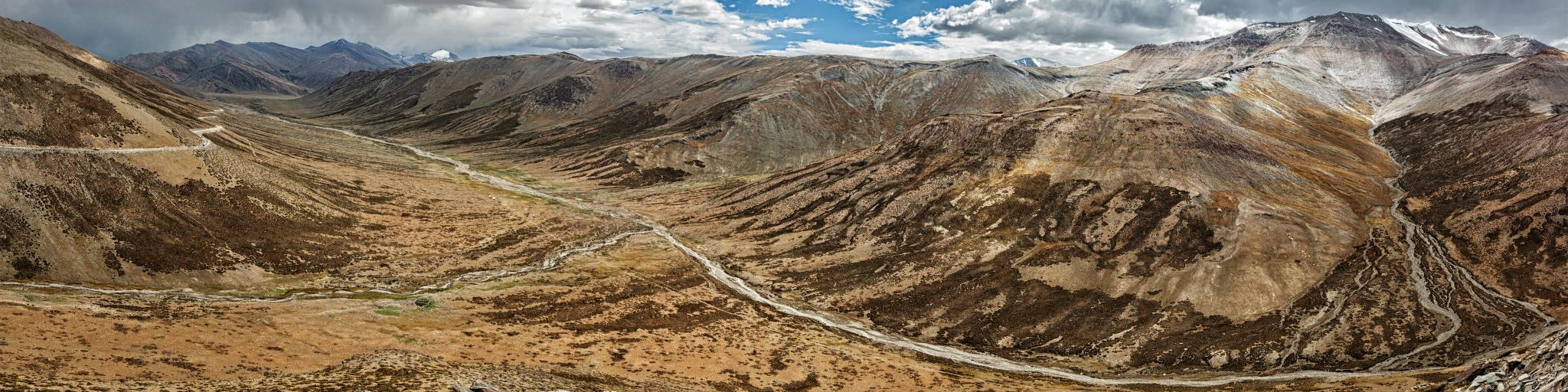 The dramatic landscape of one of the highest roads in the world - the Tangla La pass in the Ladakh region of Kashmir, India