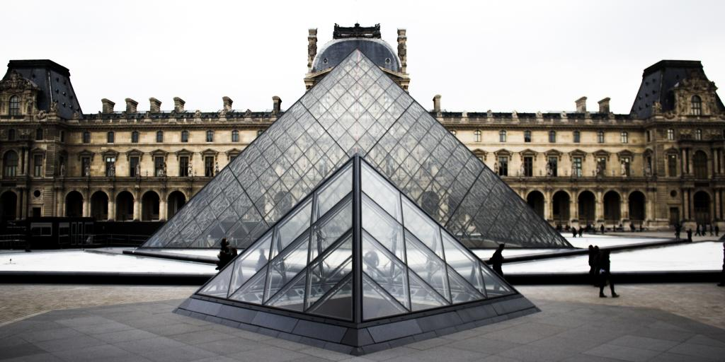 The iconic glass pyramid stands in front of the Louvre Museum in Paris