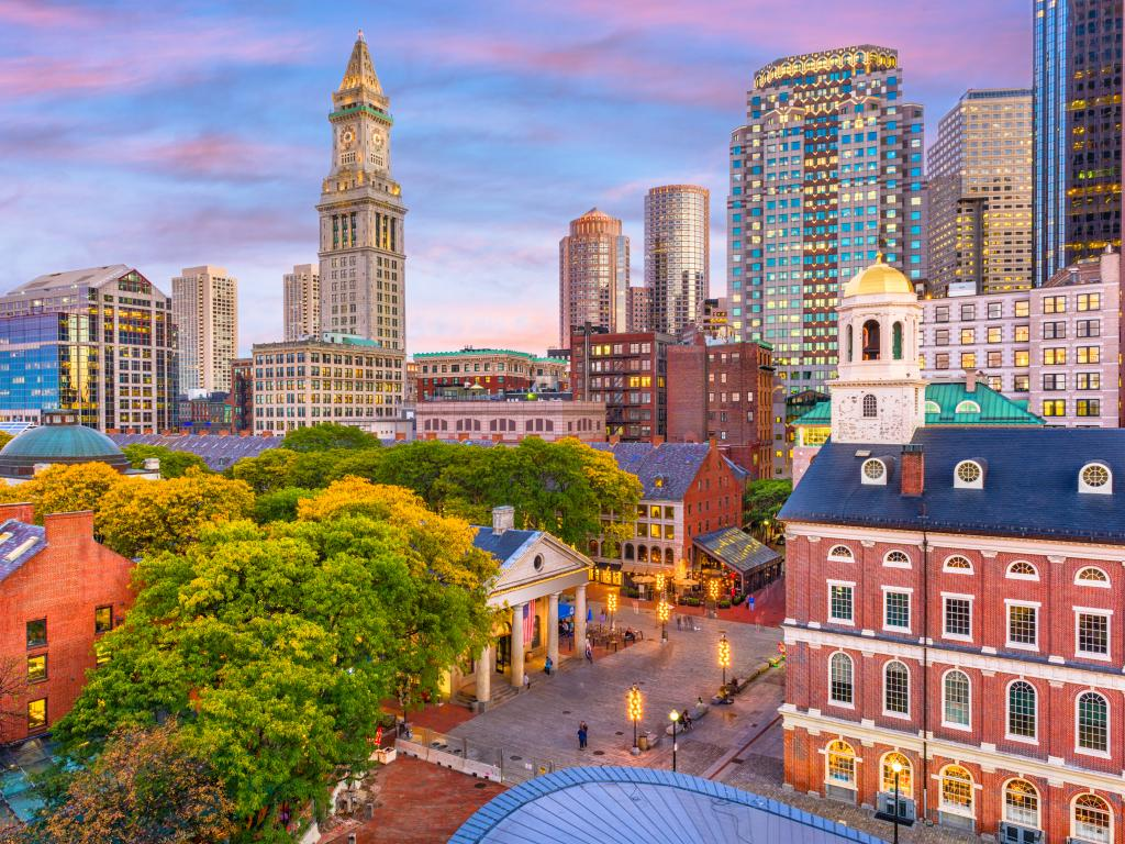 Downtown Boston with the Faneuil Hall and Quincy Market at dusk.