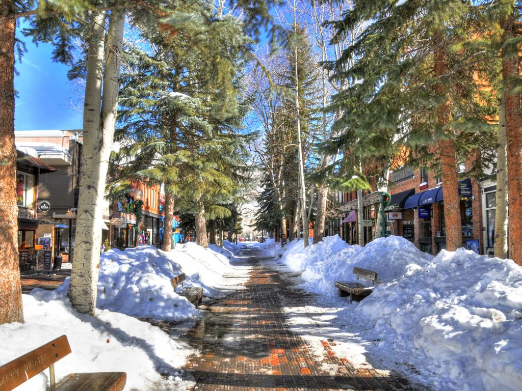 Shops and restaurants along a snowy street in central Aspen on a clear February day