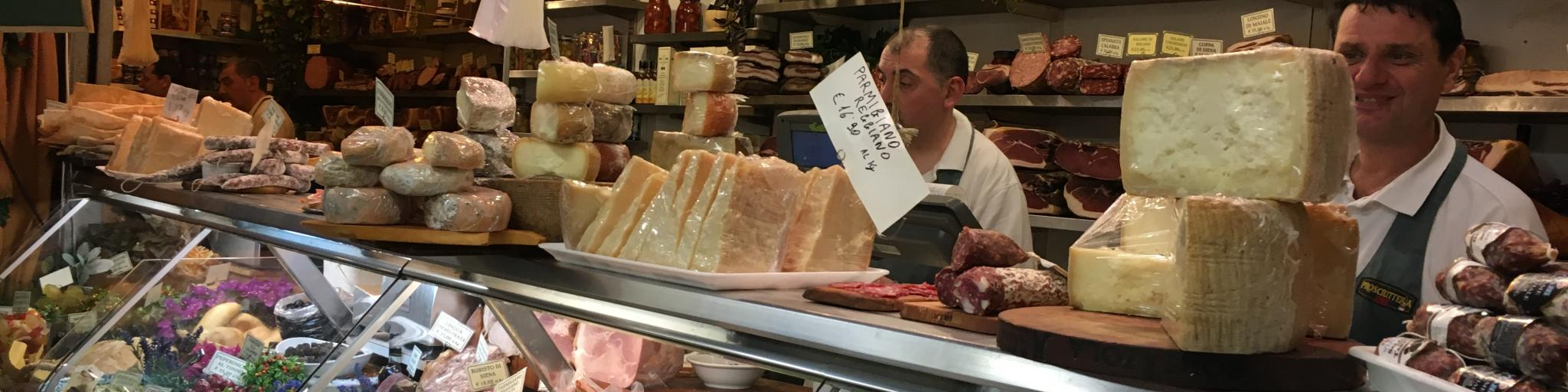 Vendors selling cheese, meat and local produce in Mercato Centrale in Florence