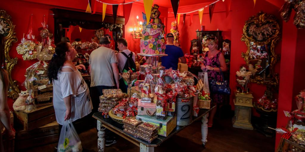 People admiring the cakes at Choccywoccydoodah, Brighton