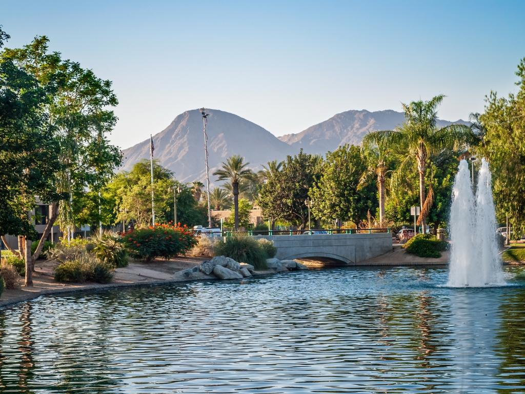 A park with palm trees and a fountain in Palm Springs, California