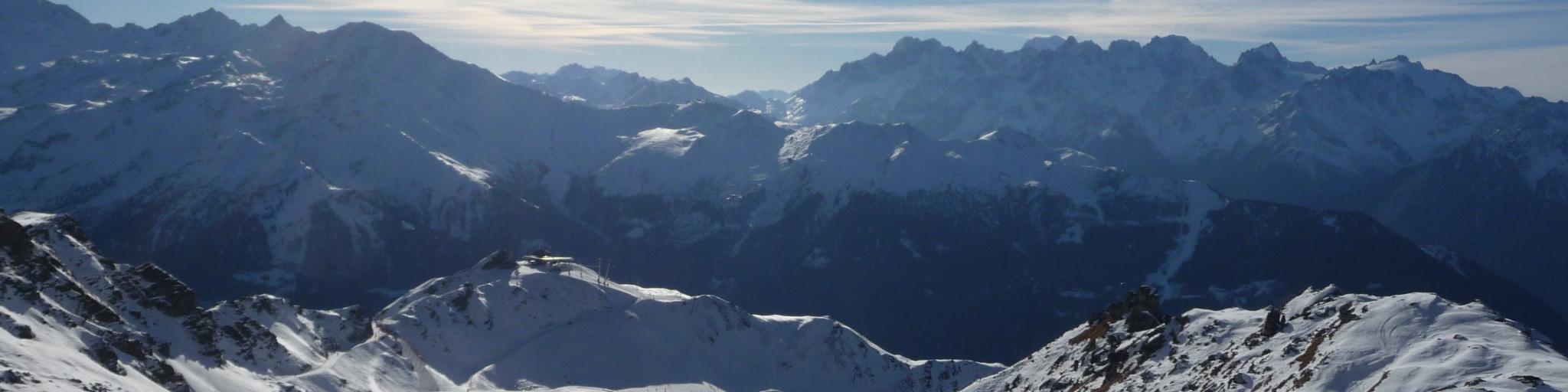 Skiers admiring the mountainous views in Verbier, Switzerland