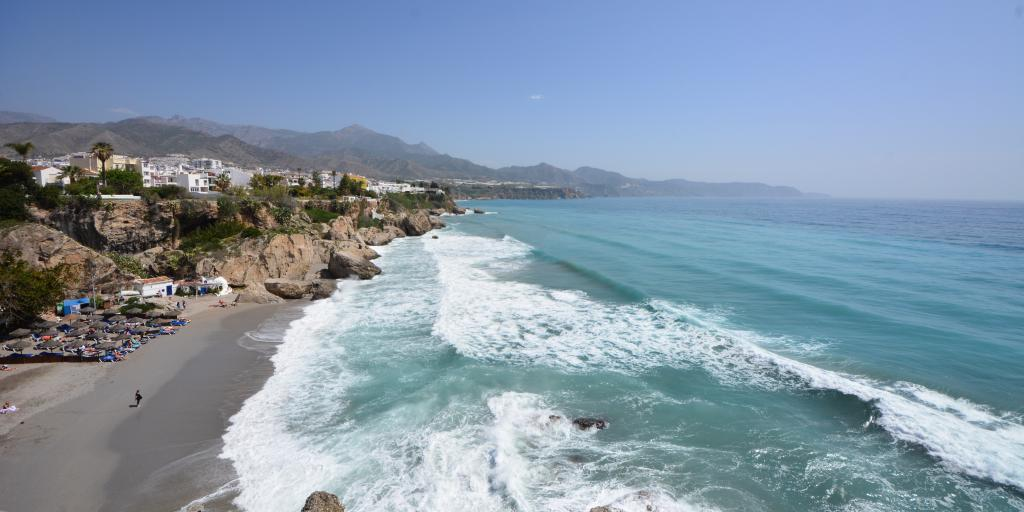 Waves crash against the coast in Nerja, Spain