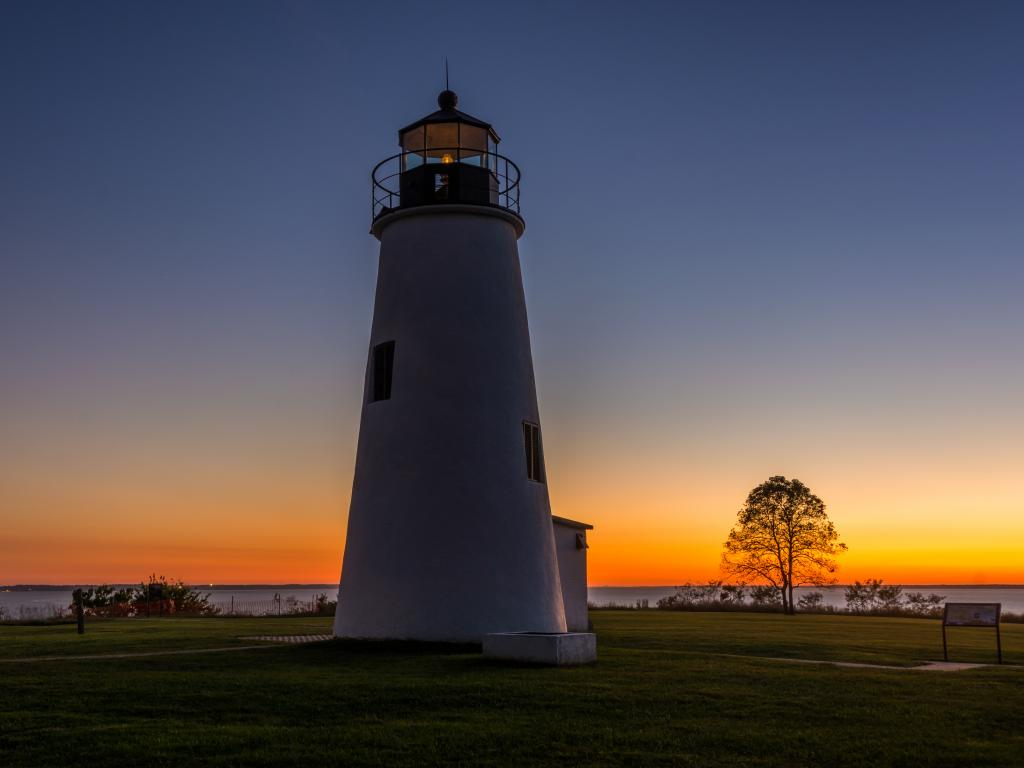 Turkey Point Lighthouse near  with the shore and the beautiful sunset at the back at  Elk Neck State Park, Maryland