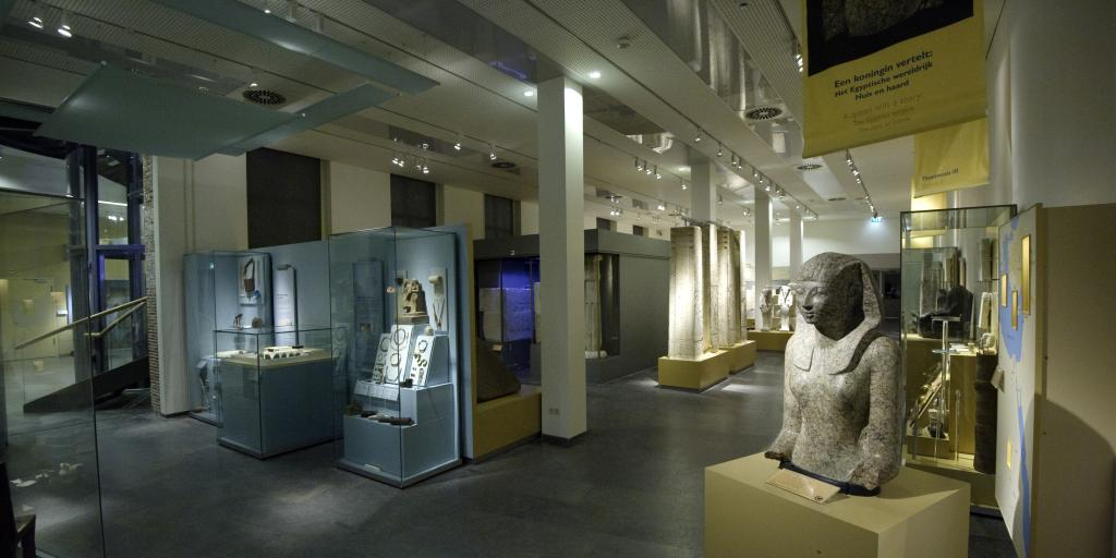 Egyptian relics on display in glass cases in Leiden's Rijksmuseum van Oudheden