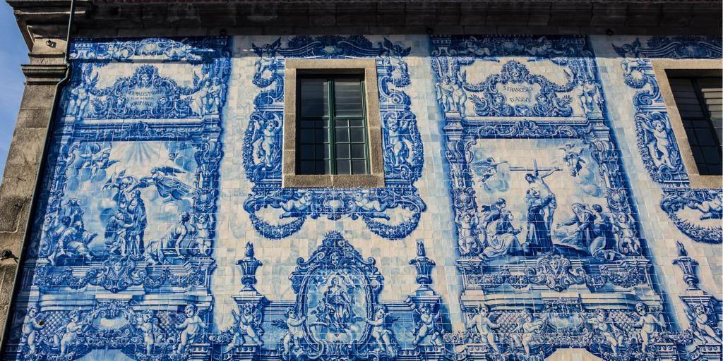 Distinctive blue and white tiles on the walls of Chapel of Souls in Porto, Portugal