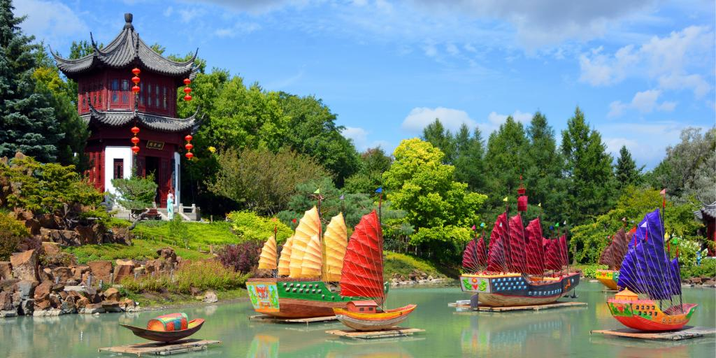 Colourful boats and a hut in the Chinese garden