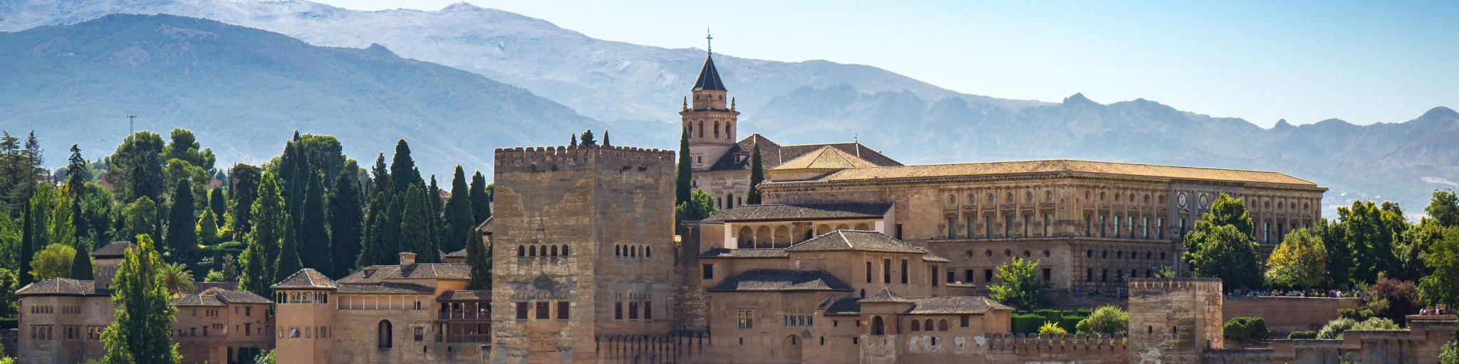 The Alhambra fortress towers over the city of Granada amid the Sierra Nevada mountains in Spain