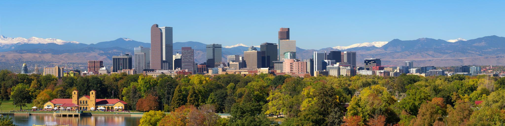 Denver city skyline with snow capped Rocky Mountains in the background