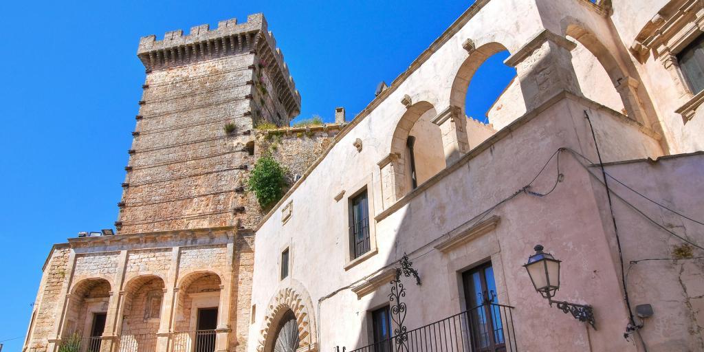 The turret of Ducal Castle, Ceglie Messapica against a blue sky