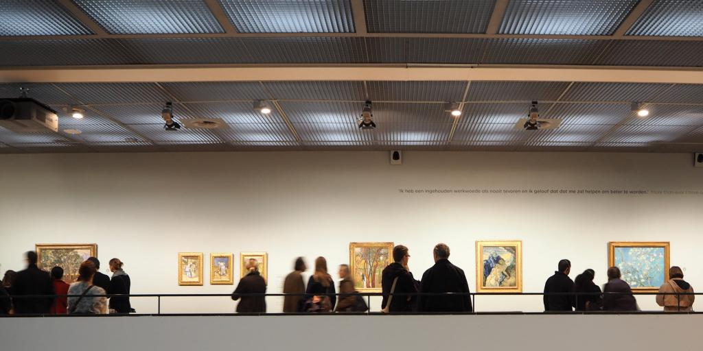 People looking at the artwork in the Van Gogh Museum, Amsterdam