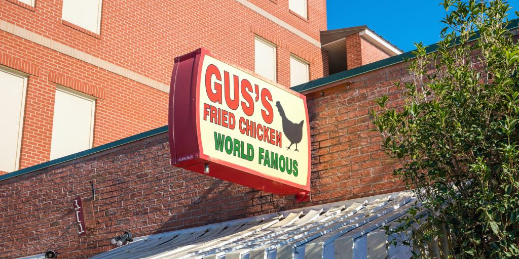 Sign outside Gus's World Famous Fried Chicken first restaurant in Memphis