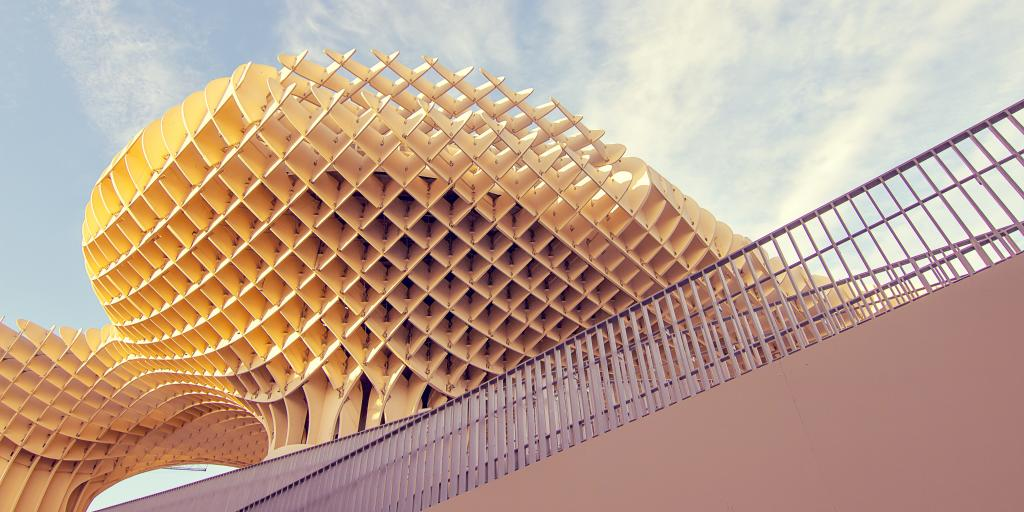 The wooden grid pattern of Metropol Parasol against a blue sky in Seville