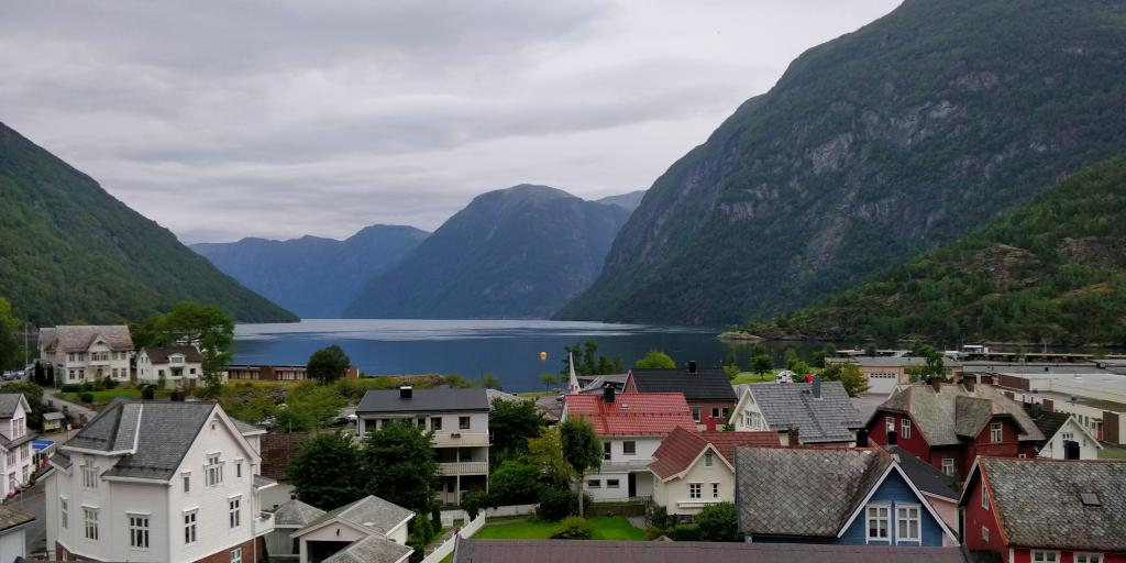 The houses of Hellesylt in Norway, with a beautiful fjord in the background