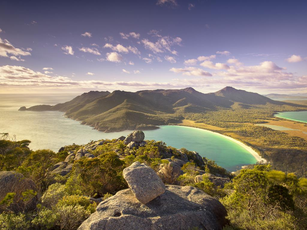 View down to Wineglass Bay from the top of Mount Amos in Tasmania, Australia