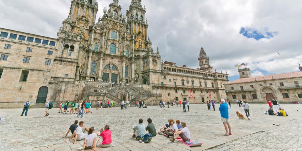Pilgrims on the Camino de Santiago arriving to Santiago de Compostela's famous cathedral