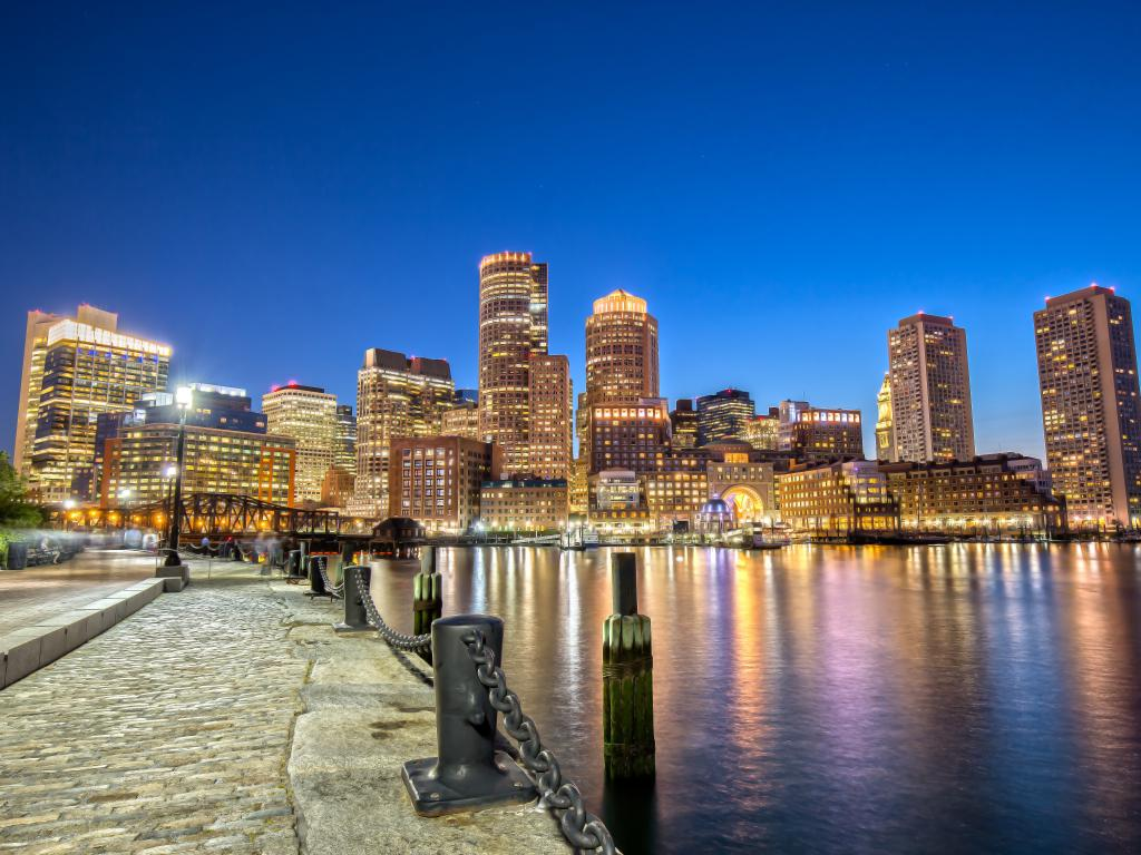 Downtown Boston as seen from Downtown Harborwalk at night - Boston, Massachusetts